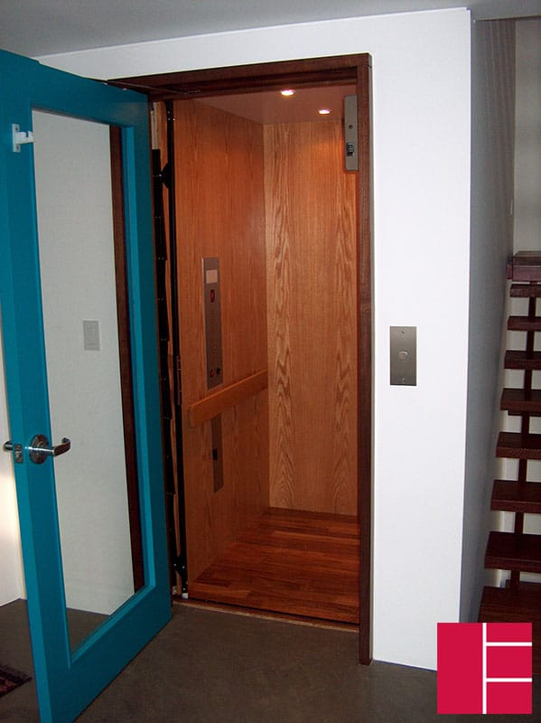 Wooden residential elevator with coloured hall swing door | Federal ...