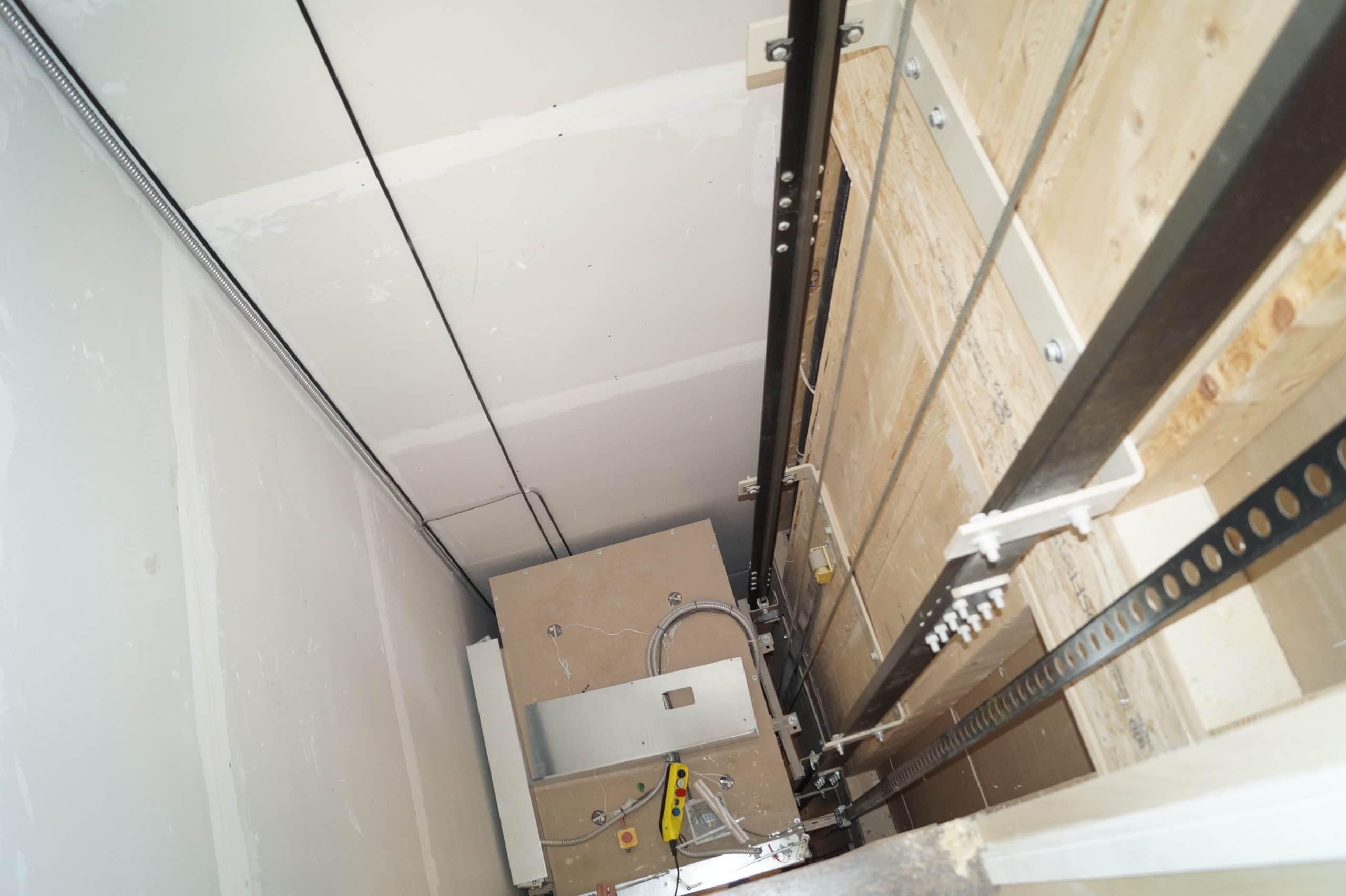 Photo showing inside of home elevator hoistway/shaft
